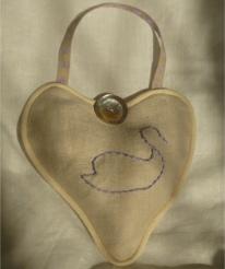hand embroidered emblem on lavender bag
